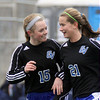 Jeff Krage – For Shaw Media<br /> Geneva's Mary Landry, right, is congratulated by Annie Waldoch after giving the Vikings a 3-0 lead in the first half of Saturday's game at West Aurora.<br /> Aurora 3/29/14