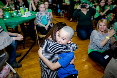 Michelle LaVigne/ For Shaw Media Nine-year-old Chris Validejuli receives a hug from his mother Julie after getting his head shaved during the Shamrock Shave Charity Fundraiser at St. Margaret Mary School in Algonquin on Saturday, March 14, 2015.