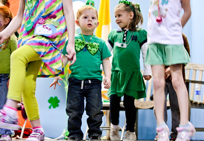 "Michelle LaVigne/ For Shaw Media Two-year-old Conner Foley participates in the Jig Contest during the Shamrock Shave Charity Fundraiser at St. Margaret Mary School in Algonquin on Saturday, March 14, 2015. Foley was no stranger to ""Jigs"" as his older sister is a member of the Mayer School of Irish Dance and would be performing at the event later that evening."