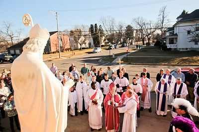 Michelle LaVigne/ For Shaw Media The most rev. David J Mallow, Bishop of Rockford leads the rededication of the St. Patrick statue at St. Patrick church in McHenry on Saturday, March 14, 2015.