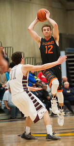 St. Charles guard Evan DiLeonardi passes the ball over Prairie Ridge guard Brian Dorn during the third quarter of the Class 4A Rock Valley Sectional playoff game in Rockford Wednesday, Mar. 9, 2016. St. Charles beat Prairie Ridge 68-44. Randy Stukenberg for Shaw Media