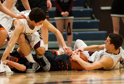 Prairie Ridge's Dylan Stenzel (right) and Brian Dorn (left) scramble for a loose ball during the second quarter of the Class 4A Rock Valley Sectional playoff game in Rockford Wednesday, Mar. 9, 2016. Randy Stukenberg for Shaw Media