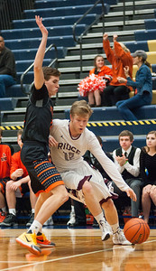 Prairie Ridge's Payton Otto has trouble driving past St. Charles guard J.T. Ford during the first quarter of the Class 4A Rock Valley Sectional playoff game in Rockford Wednesday, Mar. 9, 2016. Randy Stukenberg for Shaw Media