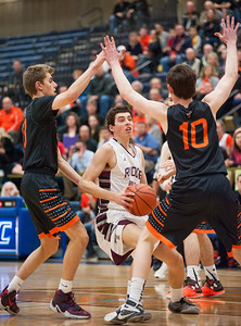 Prairie Ridge guard Brian Dorn tries to get through the St. Charles defense of Zach Hondlik (10) and James McQuillan during the first quarter of the Class 4A Rock Valley Sectional playoff game in Rockford Wednesday, Mar. 9, 2016. Prairie Ridge had trouble with the  Fighting Saints' defense all night, losing the game 44-68. Randy Stukenberg for Shaw Media