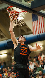 St. Charles forward Justin Hardy slam dunks the ball during the third quarter of the Class 4A Rock Valley Sectional playoff game in Rockford Wednesday, Mar. 9, 2016. St. Charles beat Prairie Ridge 68-44. Randy Stukenberg for Shaw Media
