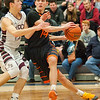 St. Charles East guard J.T. Ford drives around Prairie Ridge's Dylan Stenzel during the second quarter of the Class 4A Rock Valley Sectional playoff game in Rockford Wednesday, Mar. 9, 2016. Randy Stukenberg for Shaw Media