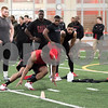 Sam Buckner for Shaw Media.<br /> Perez Ford does ladders while his teammates watch during NIU's Pro Day on Friday March 11, 2016.