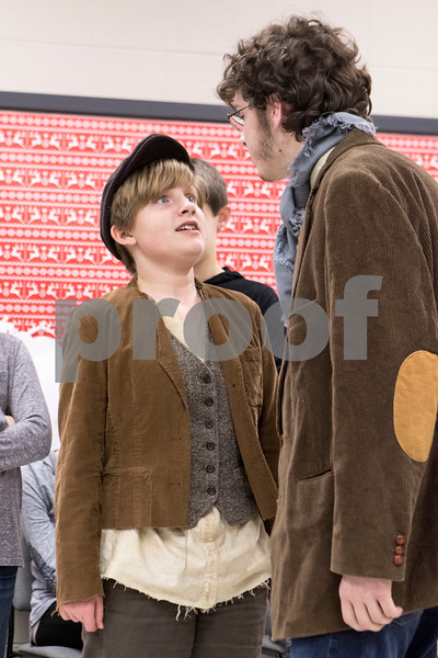"Sam Buckner for Shaw Media.<br /> Kendel Graham (Oliver) and Jacob Ihm (Bill) rehearse their rolls for the Children's Community Theatre presentation of ""Oliver"" on Tuesday March 1, 2016."