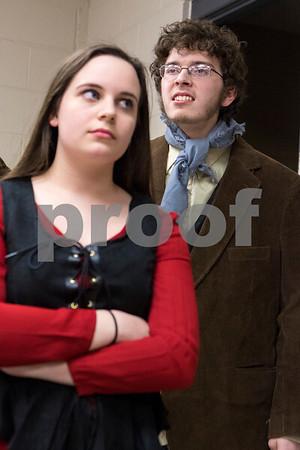 Sam Buckner for Shaw Media.<br /> Merri Bork (Nancy) glares at Jacob Ihm (Bill) in rehearsal for the Children's Community Theatre presentation of Oliver on Tuesday March 1, 2016.