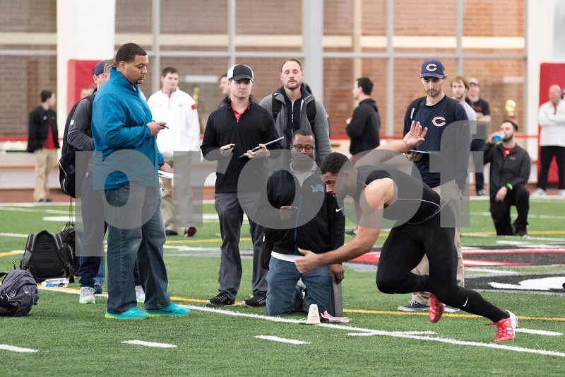 Sam Buckner for Shaw Media.<br /> Juwan Brescacin does agility drills in front of NFL scouts at NIU's Pro Day on Friday March 11, 2016.