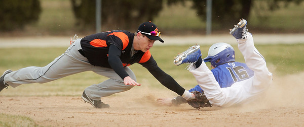 Burlington Central's Paddy McKermitt (16) slides in with a stolen base ahead of the tag by Crystal Lake Central's Blake Seegers (20) during the fourth inning of their baseball game at Crystal Lake Central on Saturday, March 19, 2016. The Rockets beat the Tigers 6-3.  John Konstantaras photo for the Northwest Herald