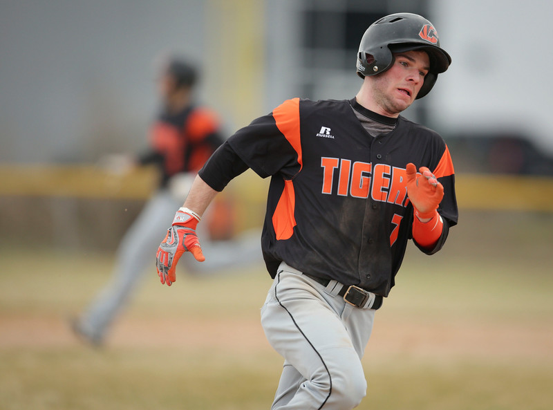 Crystal Lake Central's Logan Mensching (7) rounds third base as he scores on a hit by Adam Wittenberg (3) during the first inning of their baseball game against Burlington Central at Crystal Lake Central on Saturday, March 19, 2016. The Rockets beat the Tigers 6-3.  John Konstantaras photo for the Northwest Herald
