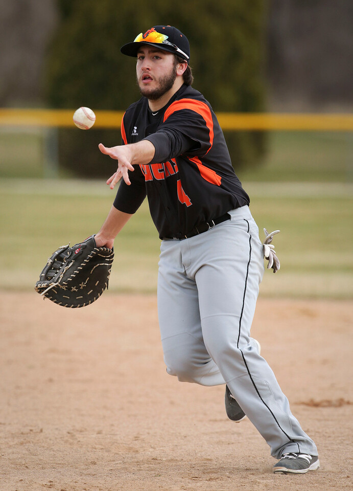 Crystal Lake Central's Luke Tevyaw (4) tosses the ball to first base to force out Burlington Central's Kyle Creadon (21) during the seventh inning of their baseball game at Crystal Lake Central on Saturday, March 19, 2016. The Rockets beat the Tigers 6-3.  John Konstantaras photo for the Northwest Herald
