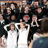 St. Charles East fans and players show their disappointment at a foul call in the final seconds of the Saints' 4A Larkin High School Regional loss to Bartlett March 1.