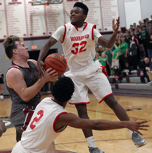 Candace H. Johnson-For Shaw Media Antioch's Ben Gutke and North Chicago's Dyshawn Gales battle for a rebound in the second quarter during the Class 3A sectional semifinal game at Antioch Community High School.
