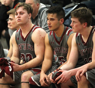 Candace H. Johnson-For Shaw Media Antioch's Ben Gutke, Michael Kawell and Logan Weber react on the bench to the final moments of their Class 3A sectional semifinal basketball game against North Chicago at Antioch Community High School.