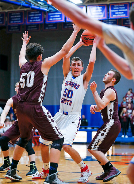 Charlie Bair (50) from Glenbard South looks to pass as Alejandro Rodriguez (50) and Blaine Borhart (5) from Marengo defend during the third quarter of their Class 3A sectional game at Genoa-Kingston High School Wednesday, March 8, 2017 in Genoa. The Indians defeated the Raiders 50-49. John Konstantaras photo for the Northwest Herald