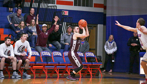 Blaine Borhart (5) from Marengo puts up the game winning 3-point basket with seconds on the clock of the fourth quarter of their Class 3A sectional game against Glenbard South at Genoa-Kingston High School Wednesday, March 8, 2017 in Genoa. The Indians defeated the Raiders 50-49. John Konstantaras photo for the Northwest Herald