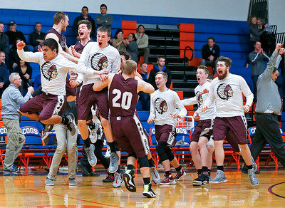 Marengo players celebrate after defeating Glenbard South 50-49 in their Class 3A sectional game at Genoa-Kingston High School Wednesday, March 8, 2017 in Genoa.  John Konstantaras photo for the Northwest Herald