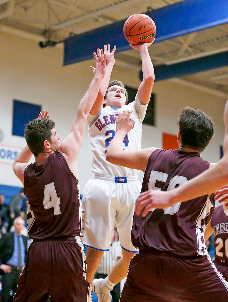 Peter Jeske (24) from Glenbard South shoots over Alexander Schirmer (4) from Marengo during the third quarter of their Class 3A sectional game at Genoa-Kingston High School Wednesday, March 8, 2017 in Genoa. The Indians defeated the Raiders 50-49. John Konstantaras photo for the Northwest Herald