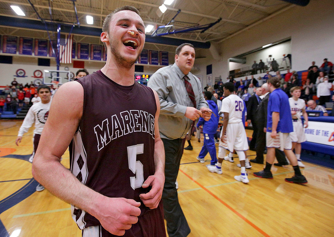 Blaine Borhart (5) from Marengo is all smiles after hitting a 3-point basket with seconds on the clock to defeat Glenbard South 50-49 in their Class 3A sectional game at Genoa-Kingston High School Wednesday, March 8, 2017 in Genoa.  John Konstantaras photo for the Northwest Herald