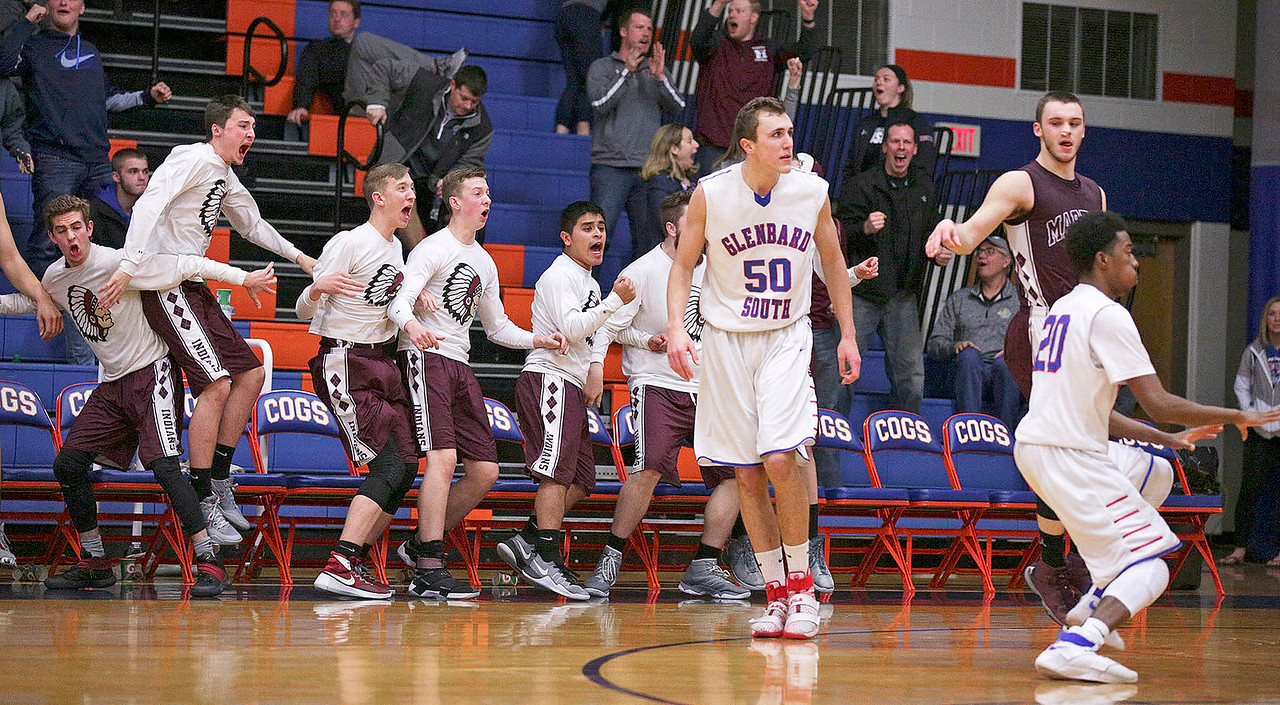 Blaine Borhart (right) from Marengo and his bench celebrate after Borhart hit the game winning 3-point basket with seconds on the clock in the fourth quarter of their Class 3A sectional game at Genoa-Kingston High School Wednesday, March 8, 2017 in Genoa. The Indians defeated the Raiders 50-49. John Konstantaras photo for the Northwest Herald