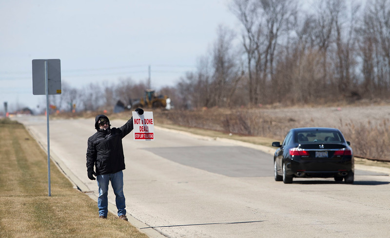 "Algonquin resident Joe  holds a sign reading ""Deal Not Done"" on Longmeadow Parkway as he joined over 50 concerned citizens to protest the expansion of Longmeadow Parkway and toll bridge on Saturday, March 11, 2017 in Algonquin, Ill.  John Konstantaras photo for the Northwest Herald"