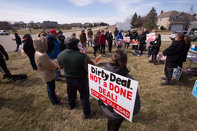 Over 50 concerned citizens gather to talk as they protest the expansion of Longmeadow Parkway and toll bridge on Saturday, March 11, 2017 in Algonquin, Ill.  John Konstantaras photo for the Northwest Herald