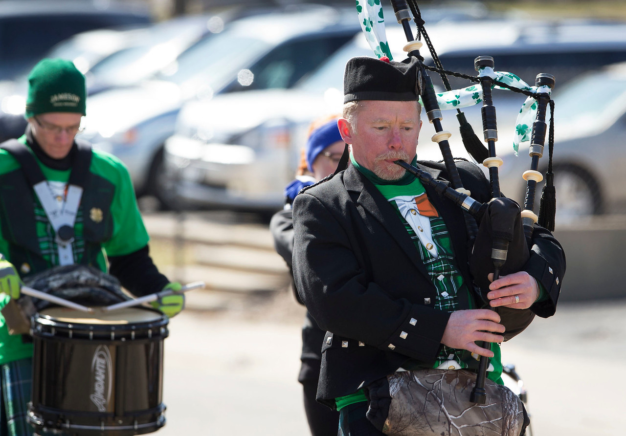 Shawn McDonald, from West Dundee, plays the bagpipe with the McDonald Family Pipe and Drum Band Plus One during the St. Patrick's Day parade on Sunday, March 12, 2017 in McHenry.  John Konstantaras photo for the Northwest Herald