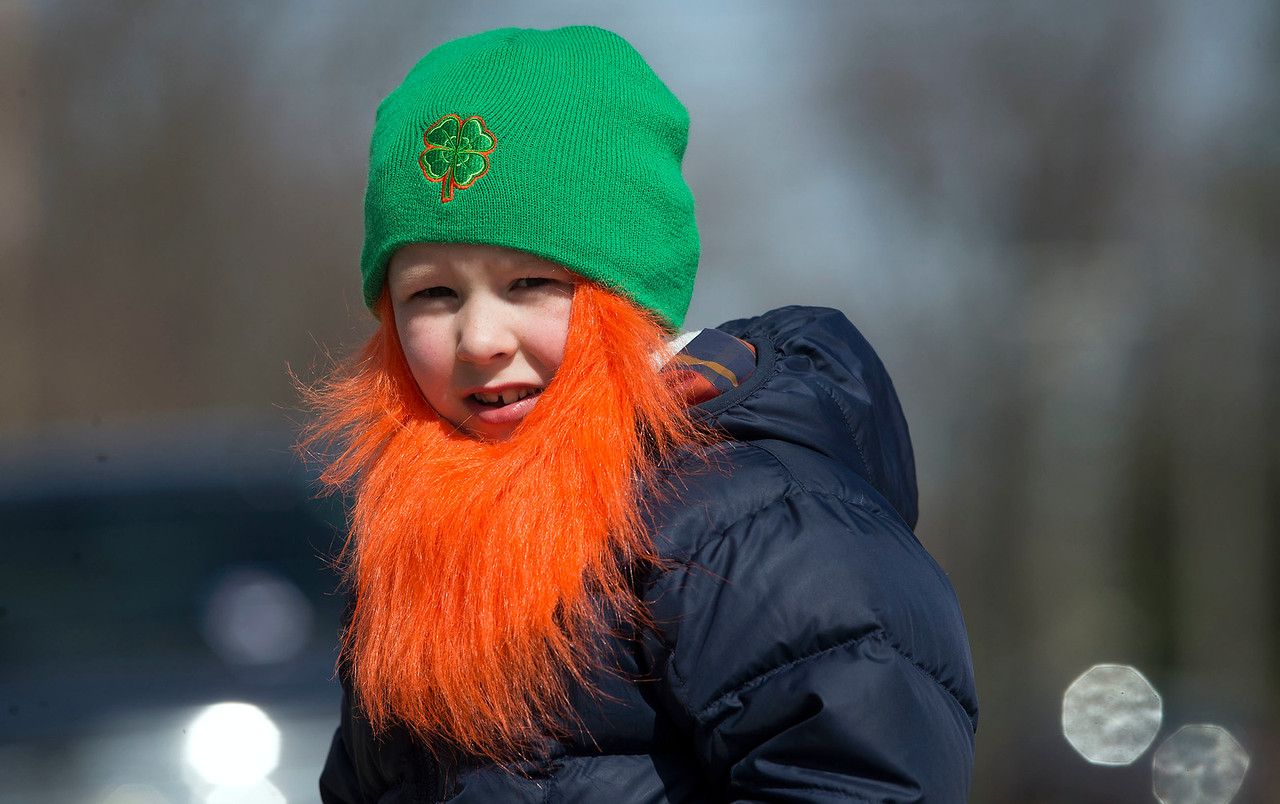 Feeling the Irish in him, Cooper Olszewski, 7 from Lake in the Hills, keeps his eye out for candy as he waits along Green Street during the St. Patrick's Day parade on Sunday, March 12, 2017 in McHenry.  John Konstantaras photo for the Northwest Herald