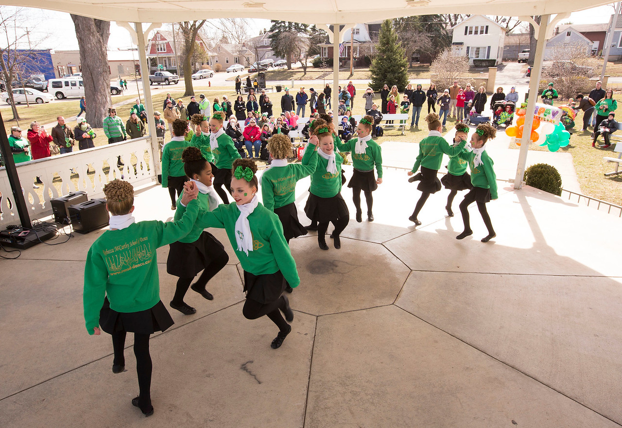 Dancers from the Rebecca McCarthy School of Dance perform in the gazebo at Veterans Park after the St. Patrick's Day parade on Sunday, March 12, 2017 in McHenry.  John Konstantaras photo for the Northwest Herald