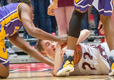 Marengo's Carter Olson (22) wrestles with Bloomington's Patrick Fisher for control of a loose ball during the first quarter of the Class 3A Super-Sectional championship game Tuesday, March 14, 2017. Randy Stukenberg for Shaw Media