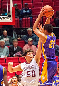 Marengo's Alejandro Rodriguez gets a hand in the face of Bloomington's Chris Payton during the third quarter of the Class 3A Super-Sectional championship game Tuesday, March 14, 2017. Randy Stukenberg for Shaw Media