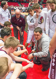 Marengo head coach Nate Wright goes over late-game strategy during a timeout in the fourth quarter of the Class 3A Super-Sectional championship game Tuesday, March 14, 2017. Randy Stukenberg for Shaw Media