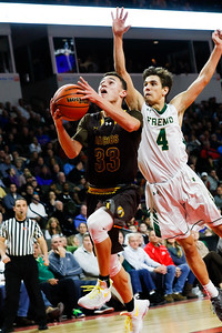 Sarah Nader - snader@shawmedia.com Jacobs' Nikolas Balkcom (left) is guarded by Fremd's Kyle Sliwa while shooting a basket during the second quarter of Tuesday's Class 4A Sears Centre Arena Supersectional  March 14, 2017 in Hoffman Estates. Jacobs lost in overtime, 35-36.