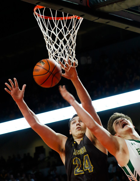 Sarah Nader - snader@shawmedia.com Jacobs; Cameron Krutwig (left) guards Fremd's Luke Schmeling while he shoots a basket during the first quarter of Tuesday's Class 4A Sears Centre Arena Supersectional  March 14, 2017 in Hoffman Estates. Jacobs lost in overtime, 35-36.