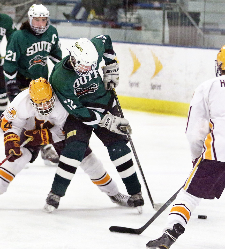 Crystal Lake South's Harrison Hinz is hit from behind by Loyola Academy's Owen Boersma during Friday's Blackhawk Cup White State Tournament championship at the Edge Ice Arena in Bensenville. The Gators lost 6-1.