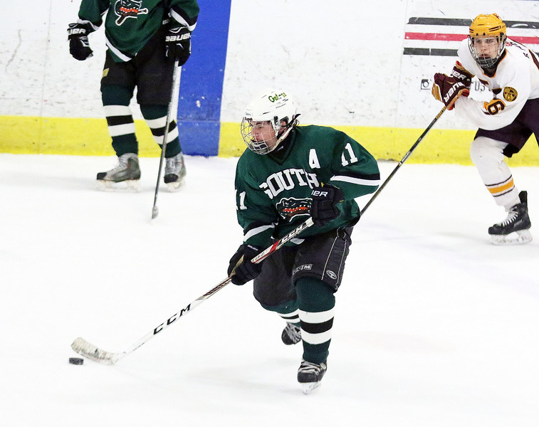 Crystal Lake South's Jake Hausch controls the puck during Friday's Blackhawk Cup White State Tournament championship against Loyola Academy at the Edge Ice Arena in Bensenville. The Gators lost 6-1.