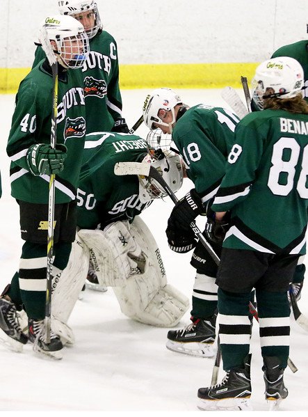 Crystal Lake South goalie Josh Albrecht hangs his head after Friday's Blackhawk Cup White State Tournament championship 6-1 loss to Loyola Academy at the Edge Ice Arena in Bensenville.