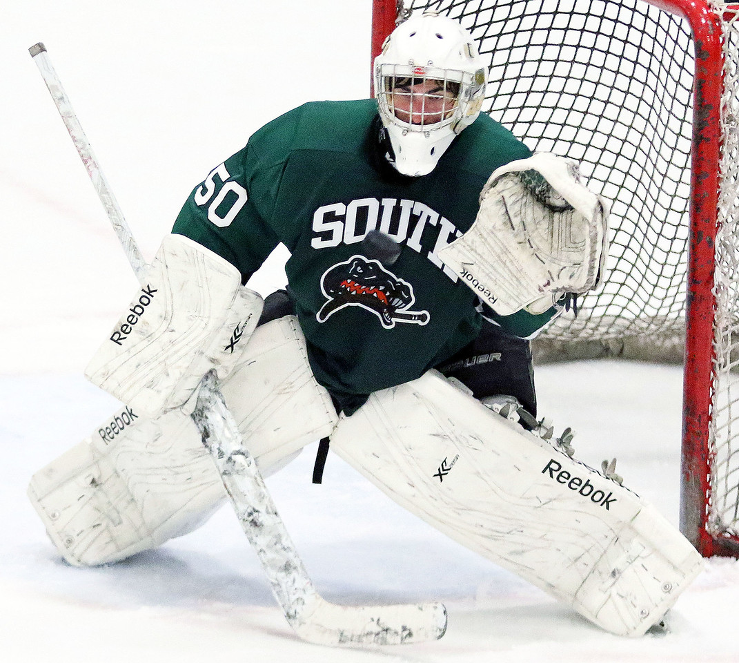 Crystal Lake South goalie Josh Albrecht gets ready to make a glove save during Friday's Blackhawk Cup White State Tournament championship against Loyola Academy at the Edge Ice Arena in Bensenville. The Gators lost 6-1.