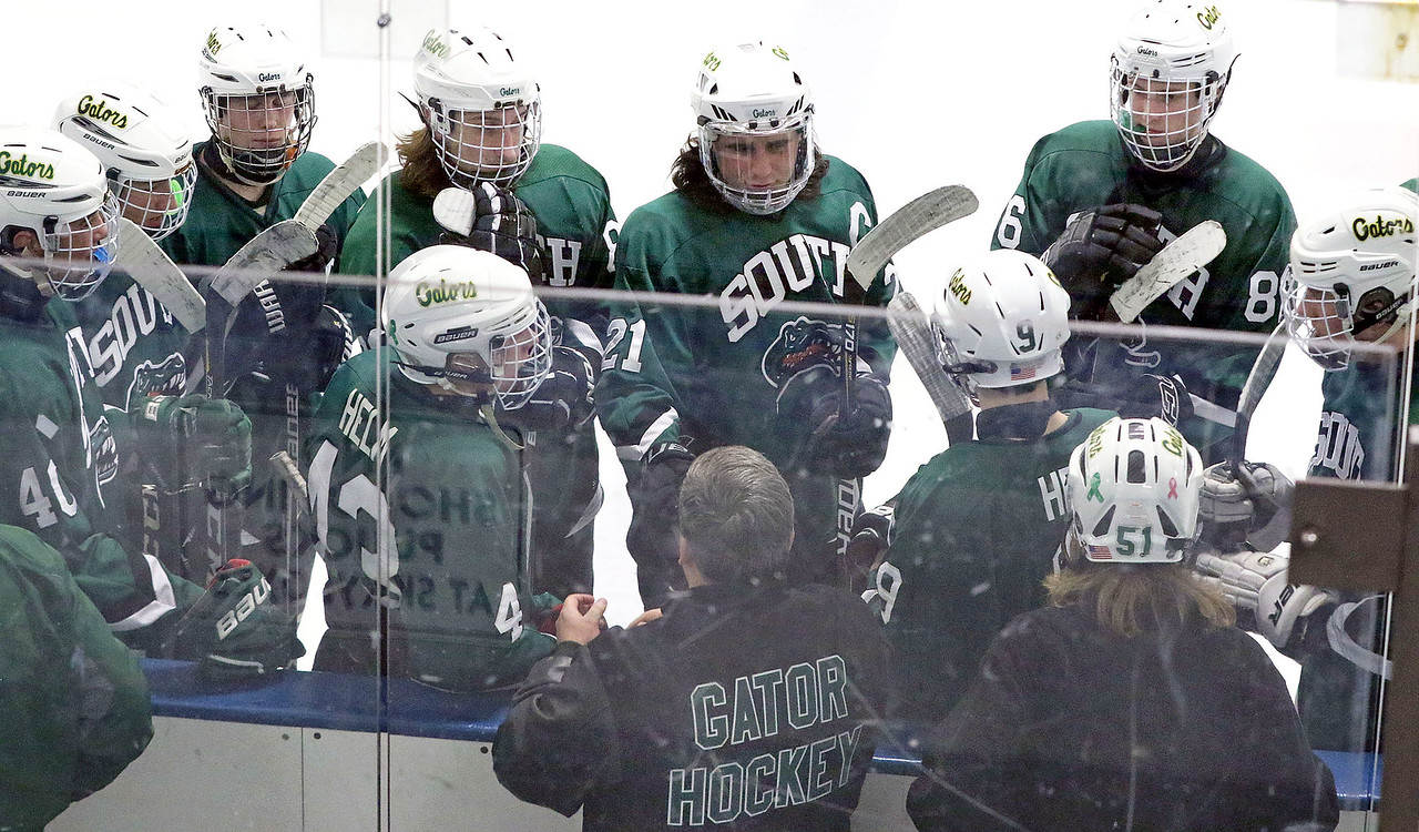 Crystal Lake South players get ready for the third period during Friday's Blackhawk Cup White State Tournament championship against Loyola Academy at the Edge Ice Arena in Bensenville. The Gators lost 6-1.