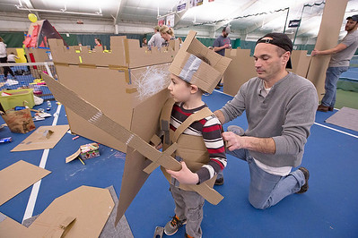 John Niziolek II, from Crystal Lake, helps his son John III with his cardboard suit of armor after finishing their fort during the First Annual Forts on the Courts Epic Fort Building Battle at The Racket Club on Saturday, March 18, 2017 in Algonquin. John Konstantaras photo for the Northwest Herald