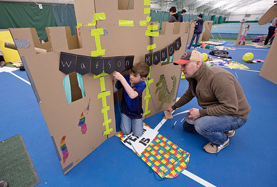 Casey Watson, from Crystal Lake, watches as his son Aidan, 9, makes a repair to the draw bridge on Watson Manor during the First Annual Forts on the Courts Epic Fort Building Battle at The Racket Club on Saturday, March 18, 2017 in Algonquin. John Konstantaras photo for the Northwest Herald
