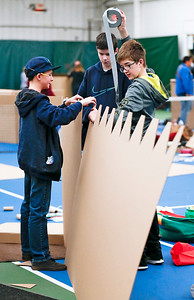 (L-R) Seth Pollin, Hayden Sanders, and Samuel Viner, all 13-years-old use duct tape to assemble their fort during the First Annual Forts on the Courts Epic Fort Building Battle at The Racket Club on Saturday, March 18, 2017 in Algonquin. John Konstantaras photo for the Northwest Herald