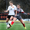 Batavia's Jessica Sneesby attempts to take the ball away from Wheaton-Warrenville South's Jennifer Aalbue during a game in Wheaton March 18.