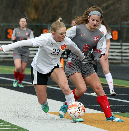 Wheaton-Warrenville South's Maria Dohse keeps the ball away from Batavia's Cameron Hindel during a game in Wheaton March 18.