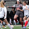 Batavia's Mackenzie Foster (#13) and Wheaton-Warrenville South's Jennifer Aalbue (#15) battle for the ball during a game in Wheaton March 18.