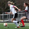 Wheaton-Warrenville South's Julia Hildebrand stays ahead of Batavia's Kelly Bleakley during a game in Wheaton March 18.