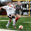 Wheaton-Warrenville South's Ellery Fahey heads up the sideline chased by Batavia's Shannon King during a game in Wheaton March 18.