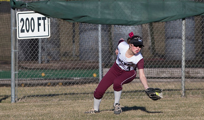 John Konstantaras - For the Northwest Herald Emelia Farnam (3) of Prairie Ridge makes a catch to put out Kaeti Miller (8) of Marian Central in centerfield during the 8th inning of their game against Marian Central at Prairie Ridge High School  on Tuesday, March 21, 2017 Crystal Lake.